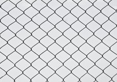 Fence texture. Black diamond-shaped fence on a blue sky background Royalty Free Stock Image