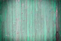 Fence thin slats painted in bright green. Background of wooden boards. Empty background with texture and vignette royalty free stock photos