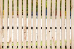 Fence of thin wooden boards between which the gap. Fence of thin light wooden boards between which the gap royalty free stock images
