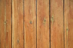 Fence from the tightly nailed wooden planks stock images
