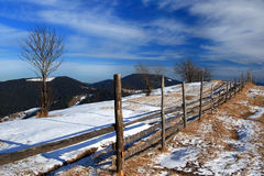 Fence on top of a snowy mountain. At the end of winter Stock Images