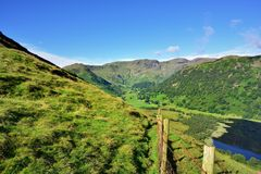 Fence and track towards Dovedale. Fairfield horse shoe above Dovedale Royalty Free Stock Photography