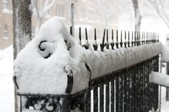 Fence under the snow. Snowy day, the fence royalty free stock photo