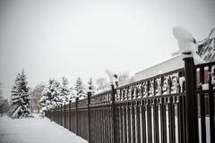 Fence under snow Stock Photo