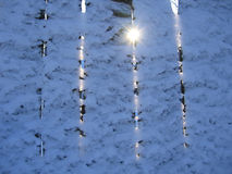 Fence under a snow and sun Royalty Free Stock Photos