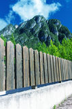 Fence underneath a beautiful mountain Stock Images