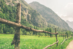 A fence in a valley. Long fence in a valley Stock Photos