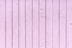 A fence of vertical pink boards. Background with a texture of wooden slats. A fence of vertical pink boards. Blank background with a texture of wooden slats stock images