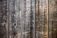 Fence of vertical, tightly fitted old, unpainted boards. With wood structure Royalty Free Stock Photography