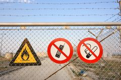 Fence with warning signs Stock Photos