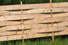 Fence waste lining_2. The unique, economical and simple protective fence from wooden waste lining. You can use it where the apiary royalty free stock photography