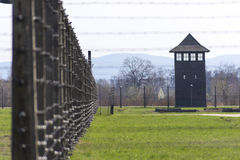 Fence and watch tower in Auschwitz concentration camp Stock Image