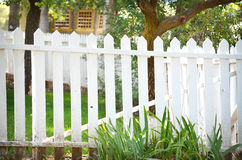 Fence. White picket fence on old farm house Stock Photography
