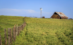 Fence windmill and barn. Farm in Stanislaus County, California, part of the fertile Central Valley Stock Photography