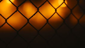 Fence wire mesh at night stock video