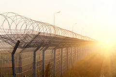 Free Fence With Barbed Wire On The Border Royalty Free Stock Image - 54119356