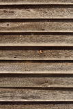 Fence wood dried by the sun. Alongside a rural road is worn wooden fence weathered, presents interesting textures Royalty Free Stock Photography
