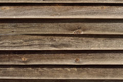 Fence wood dried by the sun. Alongside a rural road is worn wooden fence weathered, presents interesting textures Stock Photos