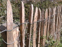 Fence in wood round fields Stock Photography