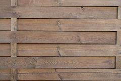 Fence of wood outdoors on brown wooden background. Surrounding, defense, protection, barrier concept royalty free stock photography
