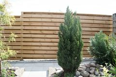 Fence of wood which is surrounding the garden and is protecting from wind and view Stock Photography