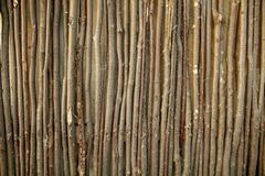 Fence of wooden branches as a background.  royalty free stock photography