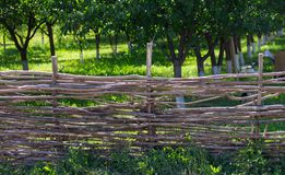 Fence of wooden branches in the garden.  stock photography