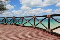 Fence of wooden bridge on sea shore. In sunny day stock photo