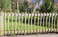 Fence with wooden pickets in the park Stock Photography