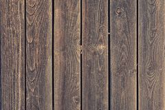 A fence of wooden planks. Background with texture of old wood. Photo for layouts. A fence of smooth wooden planks. Background with texture of old wood. Photo royalty free stock photo