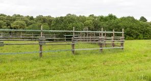 Fence of wooden poles. And beams to limit the movement of livestock, summer stock images