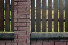 Fence of wooden rails and bricks. Close-up royalty free stock photography