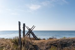 Fence with a wooden stile. By the coast of the Swedish island Oland in the Baltic Sea royalty free stock photography