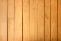 Fence from wooden vertical planks as background closeup Royalty Free Stock Photo