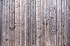 Fence from wooden vertical planks as background closeup Stock Photo