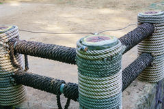 Fence wrapped with rope Stock Images