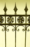 Fence of wrought iron. A section of a beautiful antique wrought iron fence in details.  Ornate design with flowers and arrow heads.  Ornamental and elegant Stock Photos