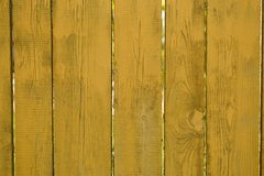 Fence yellow background for ads, wooden planks Stock Photo