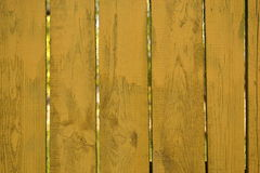 Fence yellow background for ads, wooden planks Royalty Free Stock Photos