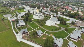Fenced area of the church in the village - Suzdal, Russia. Aerial view stock footage