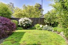 Fenced backyard garden Stock Photos