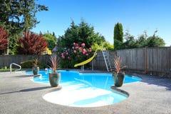 Fenced backyard with small beautiful swimming pool Stock Image