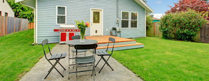 Fenced backyard with small patio area Stock Photos