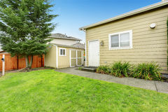Fenced backyard with small shed Royalty Free Stock Photo
