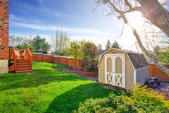 Fenced backyard with small shed Royalty Free Stock Photos