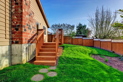 Fenced backyard with walkout deck Royalty Free Stock Photo