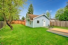 Free Fenced Backyard With Small Patio Area Stock Photos - 39001103