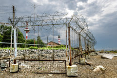 Fenced with barbed wire the territory Shepelevskii lighthouse on Royalty Free Stock Images