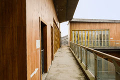 Fenced corridor of newly built buildings at sunny noon Royalty Free Stock Images