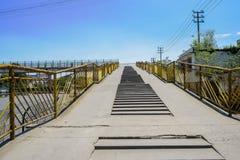 Fenced footbridge in sunny summer sky Royalty Free Stock Photo